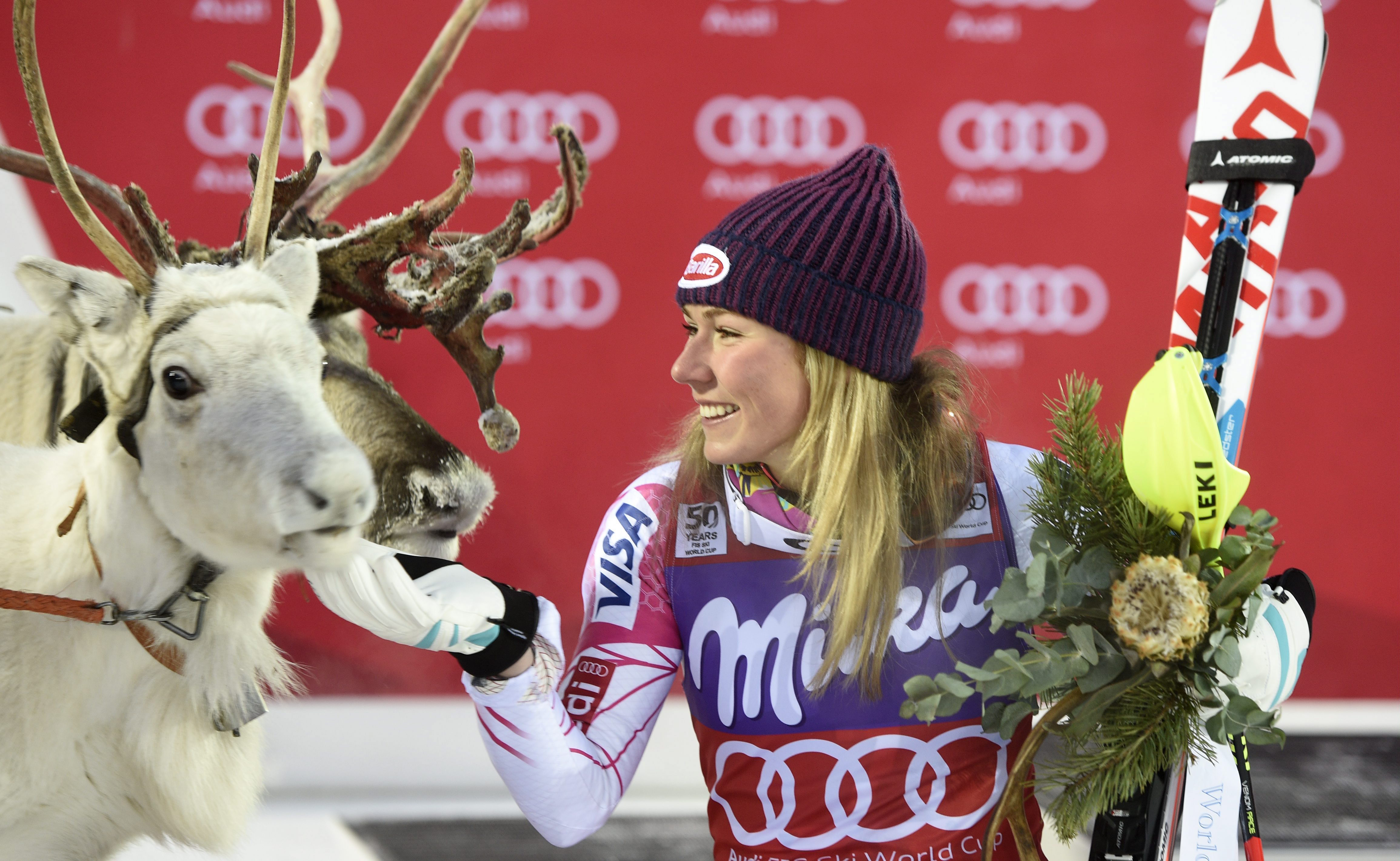 Mikaela Shiffrin poses with her reindeer Sven, won in 2016.
